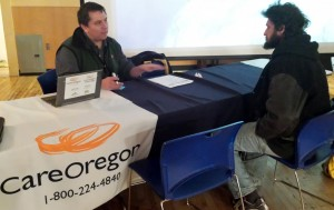 Karl Berry of CareOregon helps a guest.