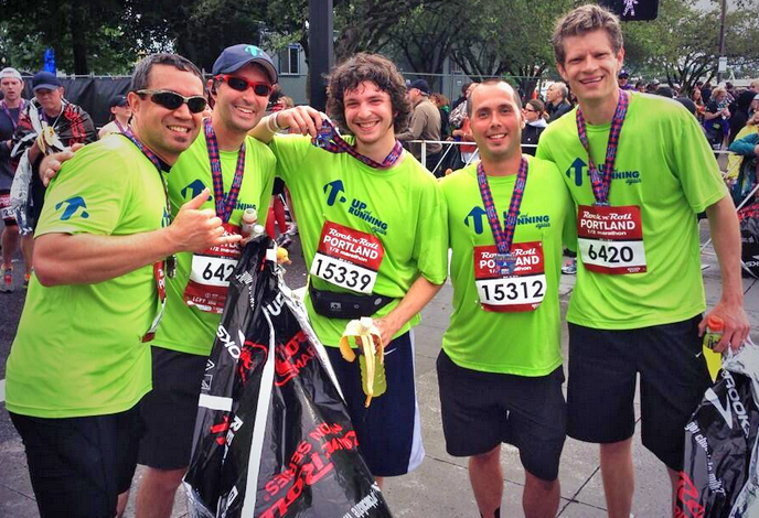 Hunter (second from right) celebrates with others from The Harbor after completing the Rock 'n' Roll Portland Half Marathon.