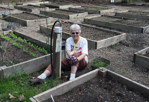 Joanne Jackson smiles as she works on the community garden at Shepherd's Door.