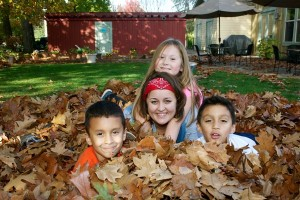 Julie Popova, and three of the kids from Shepherd's Door, enjoy some fall leaf piles.