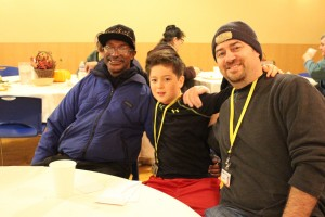 """T-Bone"" (left) sits with two of our most faithful volunteers at our 2015 Thanksgiving Dinner at the Burnside Shelter."