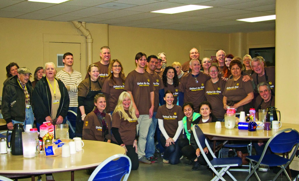 Mark Lasof and his team of volunteers pose together for a group photo after serving on Thanksgiving Day.