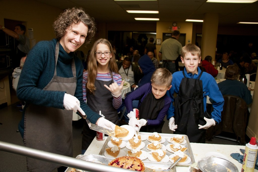 Sue (left) and her boys Mats and Zach (right) along with many others, came to serve on Christmas Eve.