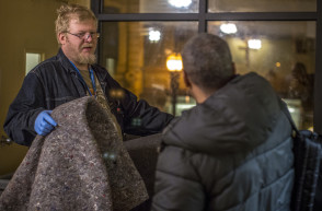 Blankets start being handed out after dinner at the Burnside Shelter.