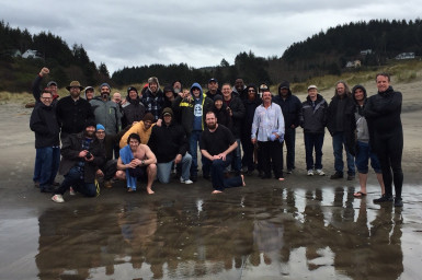 The Harbor men pose for a group photo after baptisms at their retreat at Wi-Ne-Ma Camp.