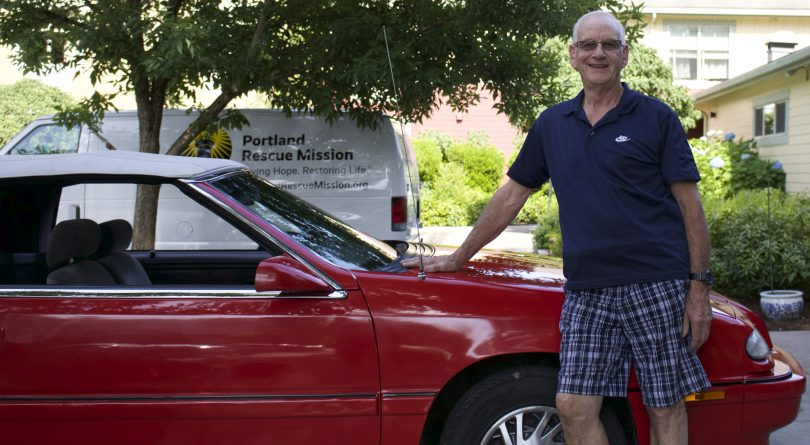 Mel Hoffman stands by his convertible from Drive Away Hunger.