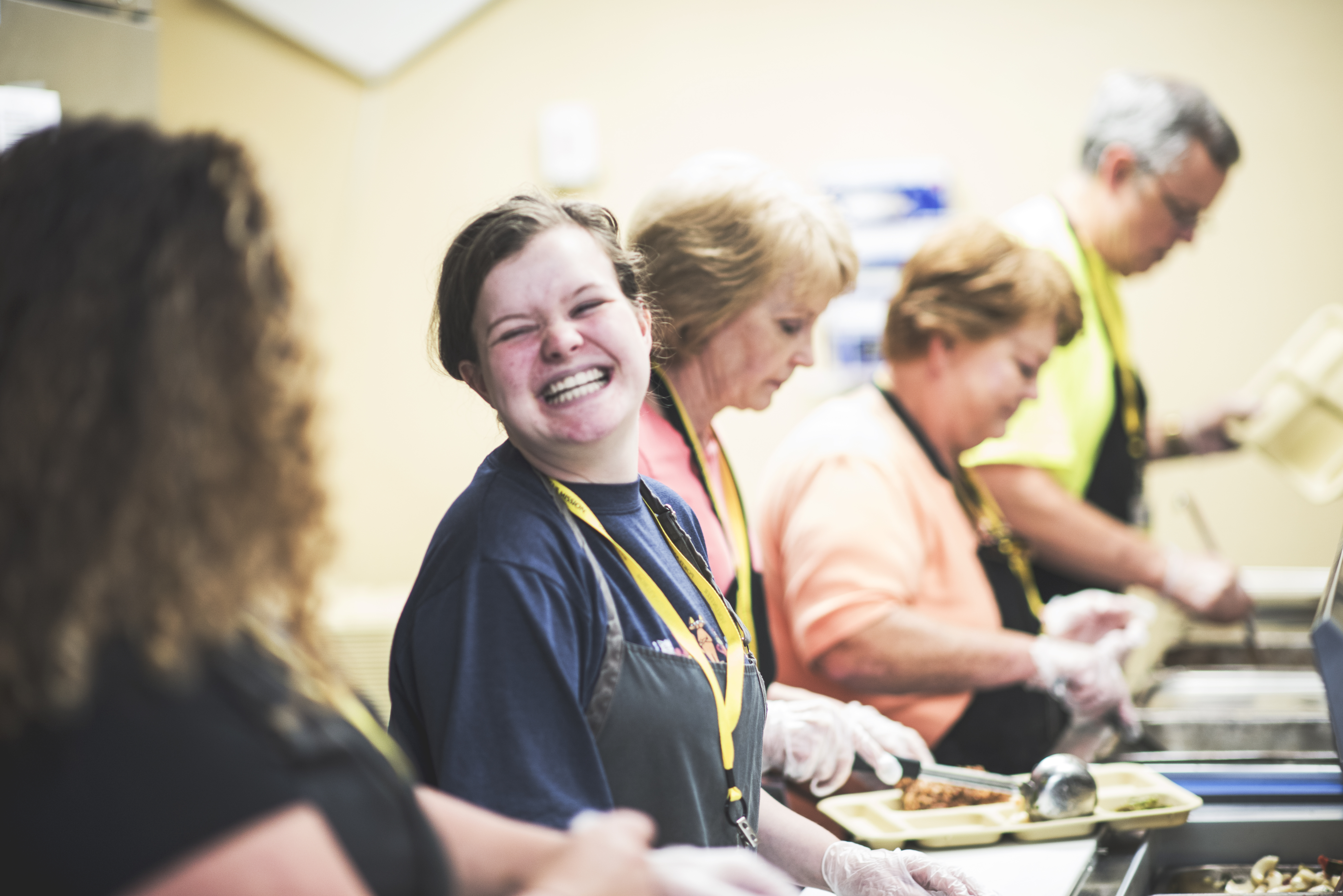 Happy Volunteer at Portland Rescue Mission Homeless Shelter