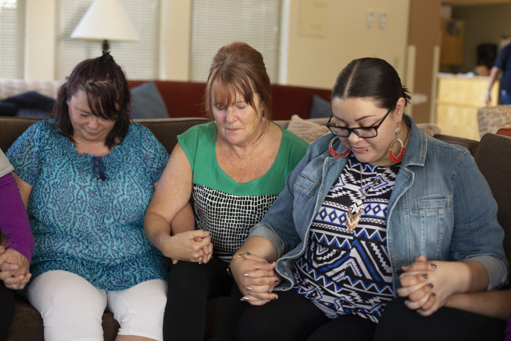 women praying at Portland Rescue Mission
